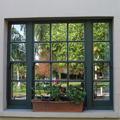 Mirror window film on window with numerous small panes