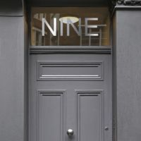 Door with vinyl cut metallic silver sticker number nine