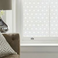 Contemporary pattern printed on frosted film and applied to the glass on a window for privacy.