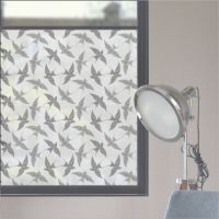 Frosted window film with a repeat pattern of swallows designed to be applied to glass.