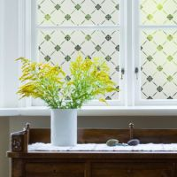 Traditional window film pattern applied to glass in a period property.