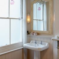 Opaque window film on a traditional bathroom window.