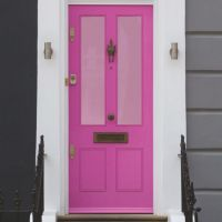 Pink frosted film on a traditional pink front door.