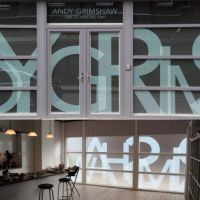 Stylish window graphics in Andy Grimshaw photographer studio.