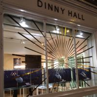 Christmas themed window graphics on Dinny Hall's Westbourne Grove jewellery shop window.