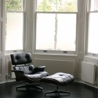 Frosted window film applied to a bay window behind Charles Eames lounge chair in Notting Hill Gate house.