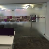 Office windows graphics for Morgan Tucker office partitions.