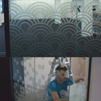 Vinyl cut geometric patterns applied to glass partitions at Moo's London office.