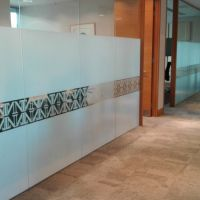 Bespoke printed glass partition graphics for Northern Trust London office.