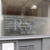 Self-adhesive printed window film with RST logo and opening hours printed and applied to glass.