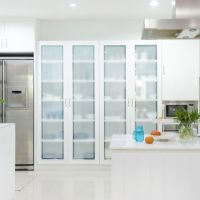 Frosted window film applied to 4 tall glass cabinets in contemporary kitchen.